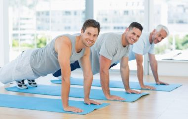 Three men plank at a yoga studio, pleased with how their sperm retrieval procedures went at PCRM's fertility clinic | PCRM Fertility Clinic Vancouver