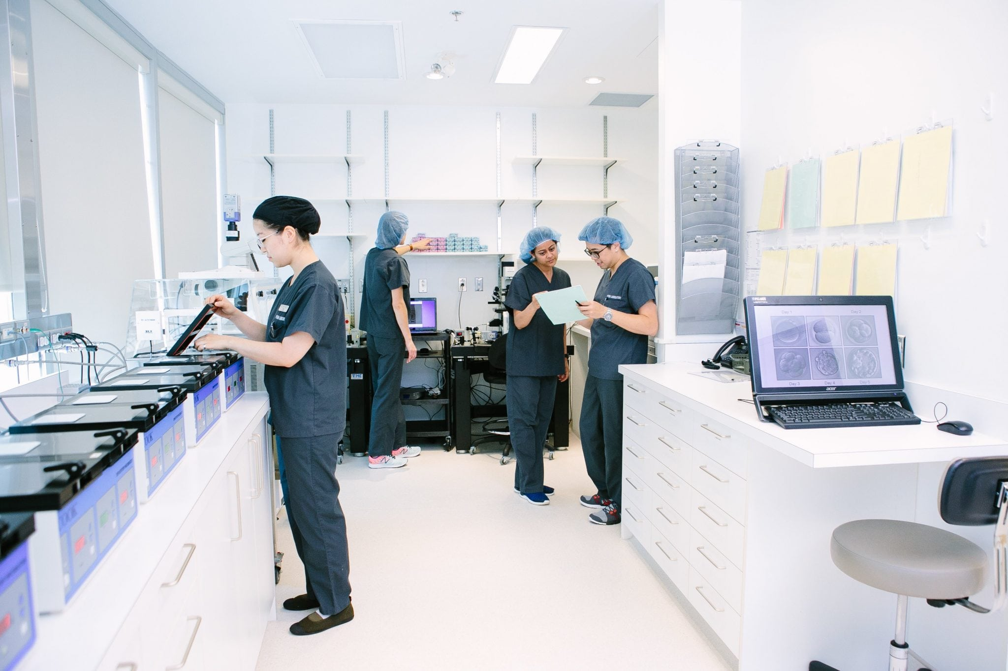 Fertility specialists at PCRM work on fertility solutions in their fertility lab | PCRM Fertility Clinic Vancouver