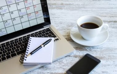 notebook with dates & coffee | PCRM Fertility Clinic Vancouver